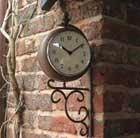 Antique rust outdoor clock and thermometer