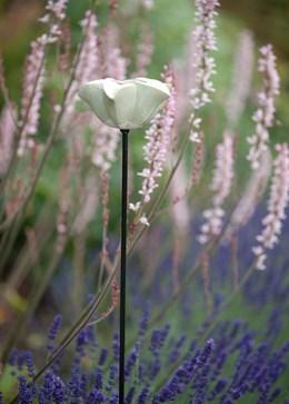 Glazed flower bird feeder on a pole