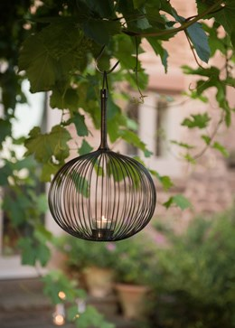 Globe tea light holder