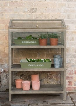 Weathered wood shelves with growing cabinet